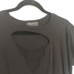 Black tee shirt with ripped holes in the front